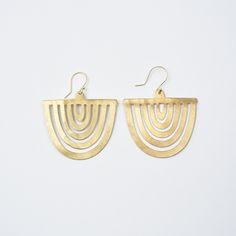 Our Sol Brass Half Sun Dangle Earrings from Ink + Alloy are so eye-catching, you…