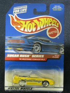 """Hotwheels '96 Mustang Convertible-Sugar Rush Series #4 of 4 #744 by Mattel, Inc.. $3.29. Hot Wheels - Sugar Rush Series - $4 of 4 - '96 Mustang Convertible (Open-Top) - 1:64 Scale Car Replica. Yellow Body Color w/""""Nestles' Butterfinger"""" on side. Rush Series, Series 4, Yellow Mustang, Home Accessories Stores, Die Games, Mustang Convertible, Custom Wheels, Rug Sale"""