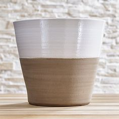 $19.95 Shop Carnivale Medium White Planter.  Two-tone terra cotta planters cache potted flowers or herbs in garden-party brights contrasted with the natural look of neutral clay.