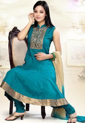 This turquoise readymade flare cotton churidar kameez with dupatta