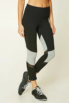 A pair of knit leggings featuring heathered panels, an elasticized waistband, and a hidden key pocket.