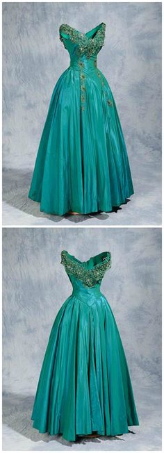 """Second night"" dress, by Willie Otey Kay of Raleigh, NC, 1954. Worn by debutante Louise Wooten to a Saturday dance the day after the 1954 North Carolina Debutante Ball.  Teal shot satin with green lace and rhinestones on the bodice, zipper closure on side. North Carolina Museum of History."