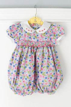 18 Months: Smocked Baby Girl Bubble Romper, Cute for Spring & Summer, vibrant pink, blue, and green floral fabric with flower smocking