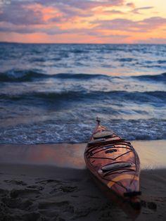 with a kayak on the beach