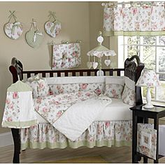 This rose 9-piece baby bedding set was created by JoJo Designs. This set includes a blanket, crib bumper, crib skirt, fitted sheet, toy bag, decorative throw pillow, diaper stacker, and two window valances.