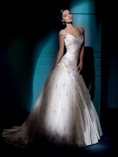 Sposabella 4275 -- Demetrios. This is a beautiful gown and I love the little caplet sleeves.