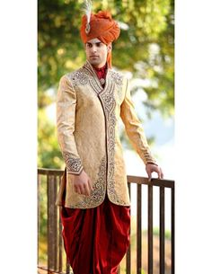 Regal touch in this beige color brocade angrakha pattern indo western sherwani and paired with red patiala.  Amazing scarf with antique brooch is reflecting its exclusivity. If you want to add class and panache to your wedding attire then you have to choose.   http://www.bharatplaza.in/ready-to-ship/sherwanis/regal-touch-patiala-sherwani-sij6067.html