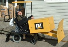 Super Doc 2006 Wheelchair Costumes. Daddy and Doc took over in 2006 after seeing a little bulldozer working across the street for a few months. Doc wanted to be one! Cardboard Engineers!! CAT sent him some great presents when they saw this. https://www.facebook.com/media/set/?set=a.234234536699046.49743.234230786699421&type=3