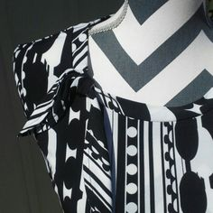 "HOST PICK Black and White Top with Tie Print Mixing Party 11/13/14. Black and white top with stripe and circular design. 95% polyester, 5% spandex stretchy material. Says size small, but could fit a medium, too. My dress form is 34-29-34"" and it fits her nicely. No stains, tears, or other damage.  No trades, Paypal, or holds. Worthington Tops"