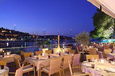 Val Marina restaurant terrace and port of Hvar.