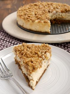Sweet, cinnamon-y cheesecake is topped with a layer of pear crisp in this delectable Pear Crisp Cheesecake. - Bake or Break