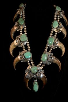 Rare Bear Claw and Turquoise Squash Blossom Necklace.: