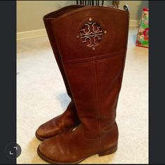 Tory Burch Riding Boots Kiernan 35mm Riding Boots - tumbled leather with gold emblem.  Almond. Signs of wear on the toe and heel. Box and Tory Burch travel bag included. Tory Burch Shoes Heeled Boots