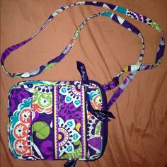 Vera Bradley Mini Hipster Crossbody The Mini Hipster offers organization in a compact silhouette. The magnetic snap on the front flap makes for easy access to the interior pockets and ID window. The adjustable strap makes it simple to customize the bag. Magnetic snap on flap Six interior slots, ID window and zip pocket Adjustable shoulder strap Zip-top closure Curved slip pocket on back, ideal for phone Vera Bradley Bags Crossbody Bags