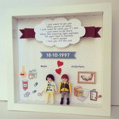 anniversary frame with two cute playmobils, details for the couple (the woman is a pharmacist and the man a psychologist) and their favorite song on the banner love!