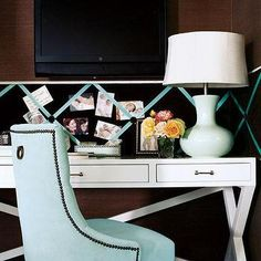Turn extra space into a a chic office, like this one, featuring blue velvet chair with nail head trim, glossy white lacquer desk, blue porcelain gourd lamp and brown grasscloth wallpaper | David Brian Sanders Interior Design