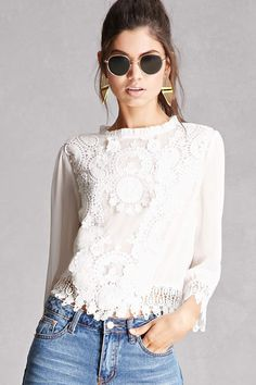 A sheer crinkled woven top featuring crochet appliques and trim, a high neckline, scalloped trim, 3/4 sleeves, a button back, and a reverse high-low hem with a self-tie back. This is an independent brand and not a Forever 21 branded item.