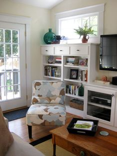 built-ins, open shelving, TV, seating