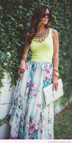 Long floral skirt design with yellow tank and accessories