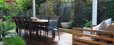 I like the idea of a wooden deck or platform to entertain. I also like the use of the sandstone edging on the garden beds and the use of the large white pots as a feature. Landscape Design, Garden Design, Wooden Decks, Outdoor Furniture Sets, Outdoor Decor, Design Consultant, Garden Beds, Garden Landscaping, Entertainment Area