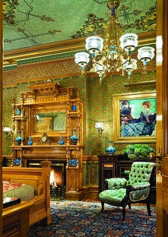 Although the mantel remained, the overmantel in the master bedroom had been removed in the twentieth century. Shadows on the plaster provided clues for its recreation. Its shelves display a few of the Loebs' Christopher Dresser-designed Minton vases. Richard Edward Miller's Seated Lady with Red Hair hangs to the right.