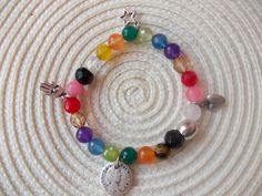 Colouring natural beads bracelet. Lucky jewelry
