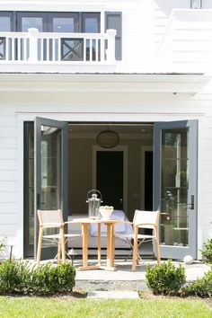 Simple Outdoor Space with Light Wood Table and Chairs outside of Bedroom | Brooke Wagner Design