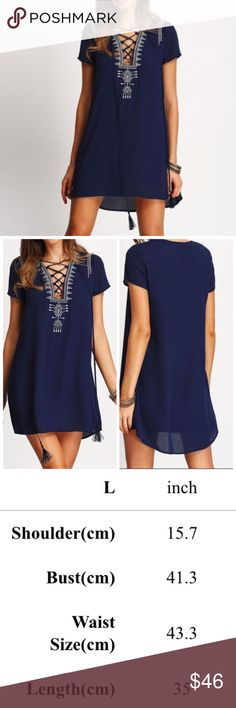 Lace Front Shift Dress Blue, fully lined, lace front shift dress with white embroidered placket and tassel tie. Slightly longer in back. Note: Dress comes in clear packaging from manufacturer to protect from dust and dirt. May require light steaming. Boutique Dresses Mini