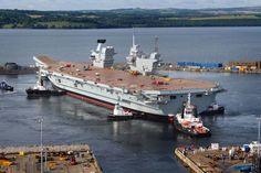HMS Queen Elizabeth under tow in Rosyth