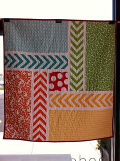 "What a fantastically fun chevron pinwheel quilt by Jessica Rider of ""A Little Gray."""