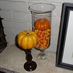 Halloween Hurricane Decor. *TIP:  To save on candy when filling large jars, add a clear plastic cup upside down in your container to create a hollow area.
