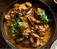 Extremely rich, medium spiced, and super delicious, this wonderful dish of succulent bite sized pieces of lamb, onions, tomatoes, yogurt, cream, and assorted spices all sautéed and simmered in ghee originated in the Punjab region and has gone on to be famous as both an Indian and Pakistani favorite. Make it as mild or as spicy as you choose, and be sure and serve it with rice or Indian flat bread to soak up all of that extremely rich and wonderful gravy!