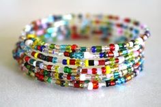 DIY Colorful Spiral Bracelet ~ memory wire & assorted beads; a 15-minute project, it doesn't get any easier than this :-) #handmade #jewelry #beading