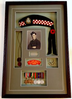 It is is always an honour to frame medals for veterans, especially ones from the First and Second World War. It is like touching greatness. This project required a seven hole collage mat for the picture, name plaque, balmoral, leather dog tags, Cape Breton badge, Pictou highlander badge, and war medals.  These are my favourite projects to do and if you have veteran medals and memorabilia to frame, I always offer a 10% discount on all projects. War Medals, Cape Breton, Name Plaques, Highlanders, World War Two, Shadow Box, Custom Framing, Dog Tags, Badge