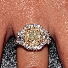 I do not like this ring but I love the color of the canary diamond in the yellow gold setting!! So gorgeous!!