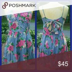 """Flying Tomato floral bustier fit n Flare dress Nwt  PLS see last pic collage pic as partial retail  tag is a hand written store  tag purchased from a small boutique a few yrs ago for an occasion..ended up wearing something else .altho I adore floral.prints I can't do them unless  """"ditsy"""" or Vtg print  Flying Tomato Pretty sure  this line runs a juniors sizing Bought this when I fit a woman's sz medium best .sorry no try ons..unable to do so for sevral reasons.  A woven fabric mayve poplin?…"""