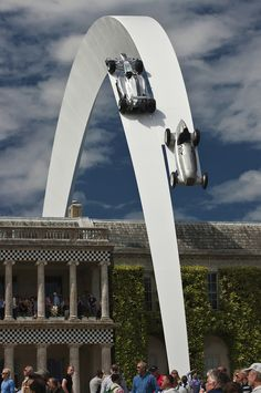 Impressive Sculpture Features Race Cars Soaring in the Sky - My Modern Met