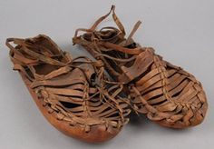Pair of men's sandals made of strips of leather thongs held together with plaited bands. Sole of sandal is also leather with incised markings for grip. Men's Sandals, Gladiator Sandals, Body Adornment, Plaits, History Museum, Thongs, British Museum, Bands, Footwear