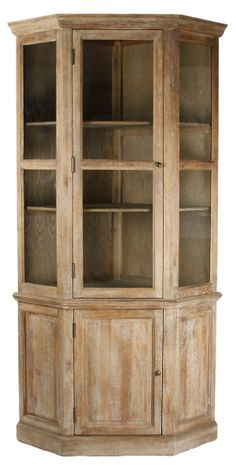Sophisticated lines and a touch of rustic warmth give this limed-oak cabinet its distinctive character. Its three glass doors open to reveal ample storage space in addition to its closed lower cabinet. Oak Corner Cabinet, Corner Display Cabinet, Corner Hutch, Tall Cabinet Storage, Corner Storage, Room Corner, Corner Shelf, Storage Shelves, Dining Room Hutch