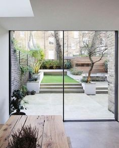"""Shed building: wood slat siding  Aitken Real Estate (@aitkenrealestate) on Instagram: """"Make your courtyard seem more spacious with the use of light colours and tall glass windows and/or…"""""""