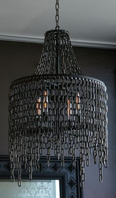 Dark design for this Victoria in chains pendant lighting chandelier made with steel and blackened nickel chain. Dark design for this Victoria in chains pendant lighting chandelier made with steel and blackened nickel chain.