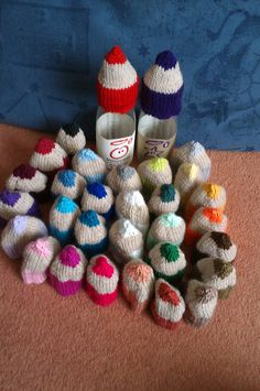 Colourful pencil hats.  For the free pattern, see my Ravelry page. My Ravelry name is  SueBeSue.