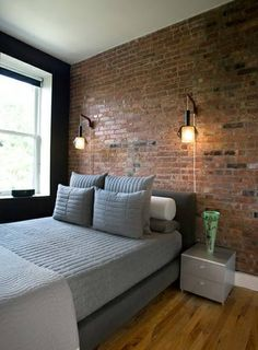 Small Studio Apartment Big Enough For Four Exposed brick Living