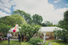 Image by Kari Bellamy - Colourful Marquee Wedding With Bride In Bespoke Gown Made By Jeni Summerfield With Mimosa Shoes From Rachel Simpson And Earrings From Jenny Packham With A Colourful Oversized Bouquet And Floral Crown With Groom In Tweed Suit From Next