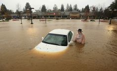 A resident of Guerneville, California, who parked his car overnight in the Safeway parking lot on Vine Street in Healdsburg, Calif., finds it nearly completely submerged as Foss Creek broke it's banks. A powerful storm churned down the West Coast bringing strong gales and much-needed rain and snow that caused widespread blackouts in Northern California and whiteouts in the Sierra Nevada. Picture: AP Photo, The Press Democrat, Kent Porter