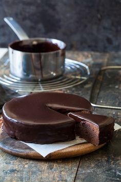 Beautiful Viennese classic cake: Sacher chocolate torte with a nice inside, a generous spread of apricot marmelade and a thick dark chocolate glaze.  | jernejkitchen.com
