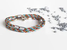 colorful kumihimo wrap bracelet with silver beads by Kreativprodukte Silver Beads, Bunt, Different Colors, Friendship Bracelets, How To Find Out, Handmade Jewelry, Etsy, Colorful, Street