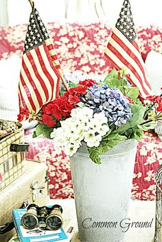 Three different colors for flowers - Red, White and Blue. Your choice of container and add flags. Assemble in under five minutes for mantel, porch or table.