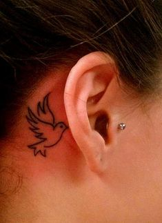 Small Bird Tattoo Behind Ear
