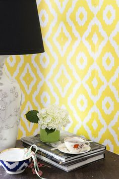 """HAZE  AphroChic's most popular pattern is back! Cover your walls in an electrifying Ikat pattern, and bring global style home.    Width: 27""""  Length: 15 feet  Untrimmed  Minimum order: 6 rolls    Ships in 3-5 weeks  $150.00 USD"""